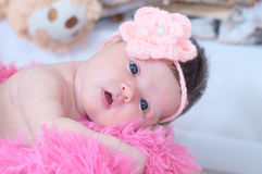 Newborn baby girl portrait lying on pink blanket, cute child. Daughter announcement Royalty Free Stock Photo