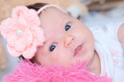 Newborn baby girl portrait lying in pink blanket, cute child. Face Royalty Free Stock Photos