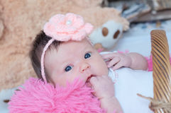 Newborn baby girl portrait in pink blanket lying in basket, cute child face. Daughter announcement stock photos