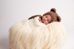 Newborn baby girl in a rabbit costume royalty free stock images