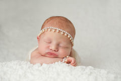 Newborn Baby Girl with Rhinestone and Pearl Headband Stock Image