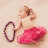 Newborn baby girl in skirt Stock Image