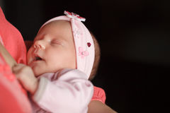 Newborn baby girl sleeping. Royalty Free Stock Images