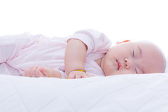 Newborn baby girl sleeping in bed Stock Photo