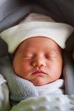 Newborn baby girl sleeping in the car seat Stock Photo