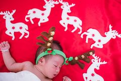 Newborn baby girl sleeping with deer stock images