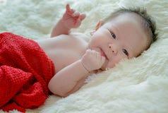 Born baby girl is sleeping on fur blanket stock photos
