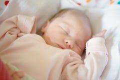 Newborn baby girl sleeping in her crib Royalty Free Stock Image