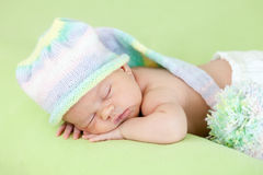 Newborn baby girl sleeping on her stomach Stock Photography