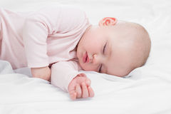 Newborn baby girl sleeping on her stomach Stock Image