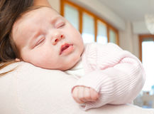 Newborn baby girl sleeping on shoulder Royalty Free Stock Photography