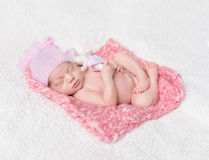 Newborn baby girl sleeping with a toy hare Royalty Free Stock Photos