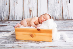 Newborn baby girl sleeping Stock Photos