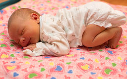 Newborn baby sleeps on bed. Stock Photography