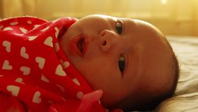 Newborn baby girl spits out the pacifier stock footage