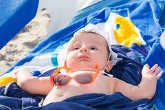 Newborn baby girl sunbathing Stock Photography