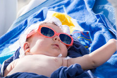 Newborn baby girl sunbathing Stock Photography