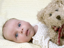 Newborn baby girl with teddy-bear Stock Images