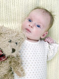 Newborn baby girl with teddy-bear Royalty Free Stock Photography
