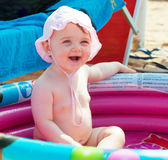 Newborn baby girl in th inflatable pool. stock photography