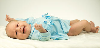 Newborn baby girl on the warm blanket. With white background Stock Photos