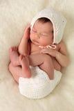 Newborn baby girl. Wearing a bonnet Royalty Free Stock Photos