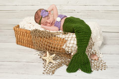 Newborn Baby Girl Wearing a Mermaid Costume Stock Photography
