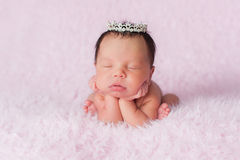 Newborn Baby Girl Wearing a Dainty Rhinestone Crown Stock Images