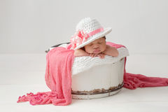 Newborn Baby Girl Wearing an Easter Hat Stock Image