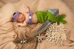 Newborn Baby Girl Wearing a Mermaid Costume Stock Images
