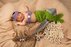 Newborn Baby Girl Wearing a Mermaid Costume stock images