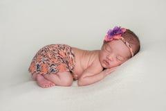Newborn Baby Girl Wearing an Orange Mini Skirt Royalty Free Stock Photography