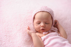 Newborn Baby Girl Wearing a Pink, Knitted Bonnet Royalty Free Stock Image