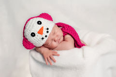 Newborn Baby Girl Wearing a Pink Snowgirl Costume Royalty Free Stock Photo
