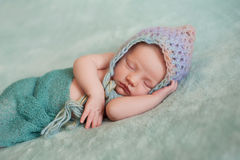 Newborn Baby Girl Wearing a Pixie Hat Royalty Free Stock Photography