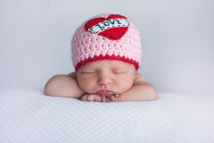 Newborn Baby Girl Wearing a Royalty Free Stock Photos