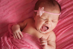Newborn Baby Girl Yawning Stock Photos