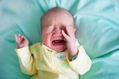 Newborn baby on a green blanket Stock Images