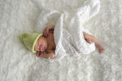 Newborn baby with green hat royalty free stock photos