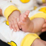 Newborn baby hand and foot. Square composition Stock Images