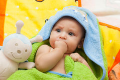 Newborn baby with the hand in his mouth. Stock Photo