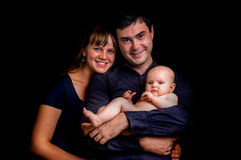 Newborn baby and happy family isolated on black. Background royalty free stock photos