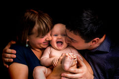 Newborn baby and happy family isolated on black. Background royalty free stock images