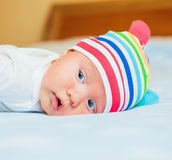 Newborn baby in the hat ... Stock Image