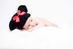 Newborn baby with hat on the head lying on blanket. Stock Photos