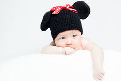 Newborn baby with hat on the head lying on blanket. Royalty Free Stock Photography