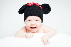 Newborn baby with hat on the head lying on blanket. Royalty Free Stock Images