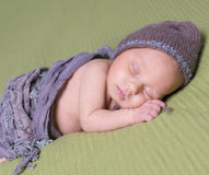 Newborn baby with hat sleeping on a blanket Stock Photography