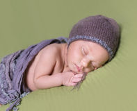 Newborn baby with hat sleeping on a blanket Stock Photo