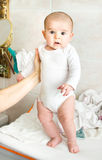 Newborn baby held up stand up thighs Stock Photo